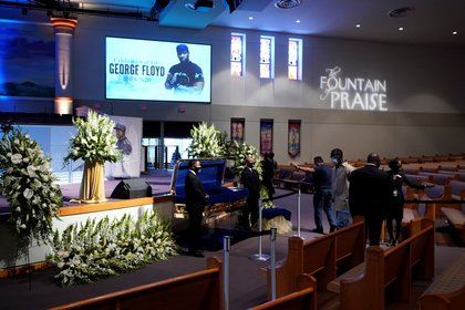 Mourners pass the casket of George Floyd during a public visitation for Floyd at the Fountain of Praise church, in Houston, Texas, USA, 08 June 2020. EFE/David J. Phillip