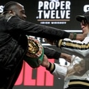 US boxer Deontay Wilder (L) and British boxer Tyson Fury get into an altercation during their press conference February 19, 2020 at the MGM Grand Las Vegas in Las Vegas, Nevada. - The boxers will fight for the World Boxing Council (WBC) Heavyweight Championship Title on February 22, 2020 at the MGM Grand Garden Arena in Las Vegas. (Photo by John Gurzinski / AFP)