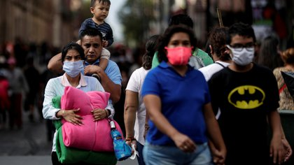 People walk near Zocalo Square during the gradual reopening of commercial activities in the city, as the coronavirus disease (COVID-19) outbreak continues, in Mexico City, Mexico July 13, 2020. REUTERS/Henry Romero