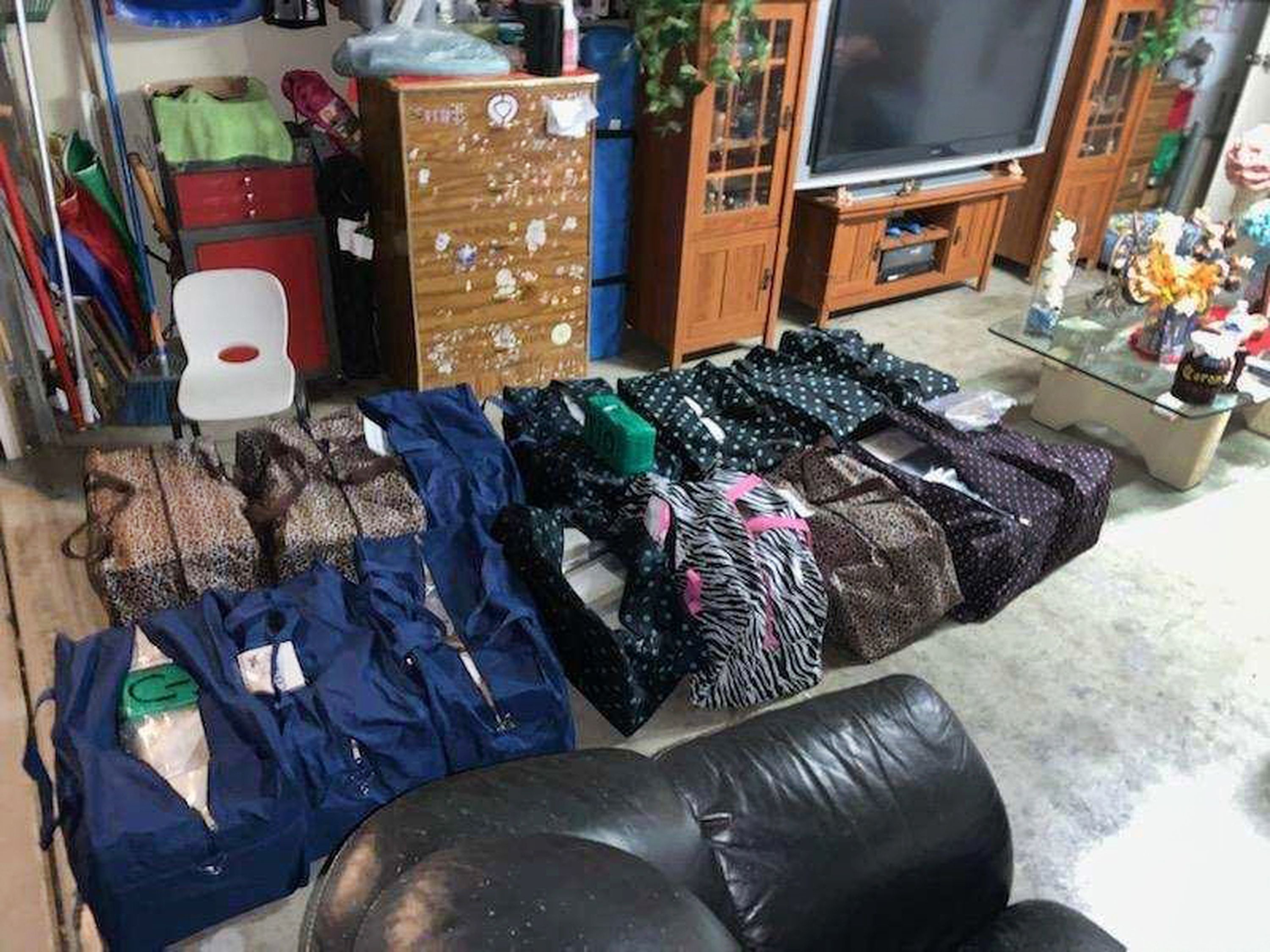 This undated image provided by the Drug Enforcement Administration shows narcotics stashed in a house in Perris, Calif. DEA agents authored state search warrants for multiple locations, including the courier target's residence and a narcotics stash house within the city of Perris, Calif. During a search of the courier's residence, agents located approximately 25 duffle bags within the garage of the residence containing approximately 406 kilograms of cocaine, six kilograms of heroin, and 650 pounds of crystal methamphetamine, and approximately 1,600 pounds of crystal methamphetamine. (Drug Enforcement Administration via AP)