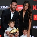 Barcelona's Argentinian forward Lionel Messi (L) poses with his wife Antonella Roccuzzo and his sons Thiago and Mateo after receiving his sixth Golden Shoe award after receiving the 2019 European Golden Shoe honoring the year's leading goalscorer during a ceremony at the Antigua Fabrica Estrella Damm in Barcelona on October 16, 2019. (Photo by Josep LAGO / AFP)