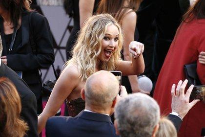 La multimillonaria franquicia de 'Los juegos del hambre' la convirtió en heroína de acción y en una de las actrices mejor pagadas del mundo (Photo by Eric Jamison/Invision/AP)