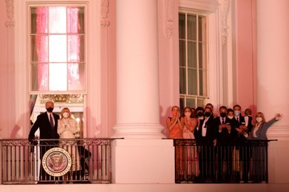 United States President Joe Biden and First Lady Dr. Jill Biden watch a fireworks display alongside family and staff from the Truman Balcony of the White House in Washington.