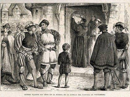 Martín Lutero clava sus 95 tesis en la puerta de la iglesia de Wittenberg