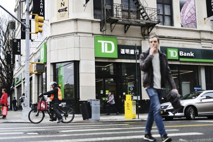 Pedestrians pass in front of a TD Ameritrade Holding Corp. bank branch in New York, New York, US., on Saturday, April 20, 2019. TD Ameritrade Holding Corp. is scheduled to release earnings figures on April 23.