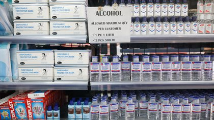 Bottles of alcohol sanitisers and boxes of face masks for protection are displayed amid the coronavirus disease (COVID-19) outbreak, in a grocery in Quezon City, Metro Manila, Philippines, July 8, 2020. REUTERS/Eloisa Lopez