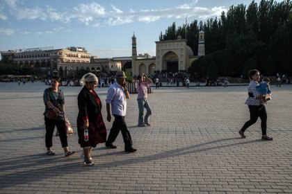 FILE -- People outside the Id Kah Mosque in Kashgar in the Xinjiang region of China on Aug. 7, 2019. A movie is part of Beijing's wide-ranging new propaganda campaign to push back on sanctions and criticism of its oppression of the Uyghurs. (The New York Times/Giles Sabrie)