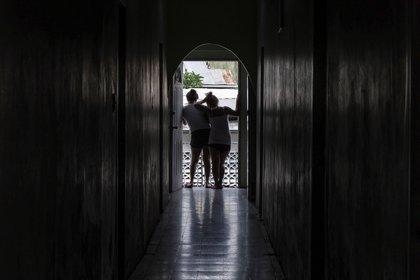 Cada vez más mujeres se encuentran atrapadas en los bares donde son forzadas a prostituirse. (The Washington Post / Jahi Chikwendiu)