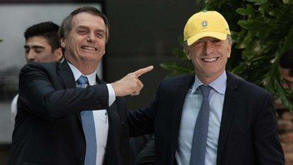 Bolsonaro sonríe junto a Macri, ayer en Buenos Aires (Adrián Escandar)