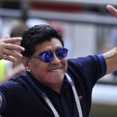(FILES) In this file photo taken on June 30, 2018 retired Argentine player Diego Maradona attends the Russia 2018 World Cup round of 16 football match between France and Argentina at the Kazan Arena in Kazan. - Argentinian football legend Diego Maradona passed away on November 25, 2020. (Photo by SAEED KHAN / AFP) / RESTRICTED TO EDITORIAL USE - NO MOBILE PUSH ALERTS/DOWNLOADS