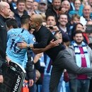 Manchester City manager Pep Guardiola kisses Manchester City's Sergio Aguero after he was substituted during the English Premier League soccer match between Manchester City and Huddersfield Town at the Etihad Stadium in Manchester, England, Sunday, Aug. 19, 2018. (AP Photo/Dave Thompson)