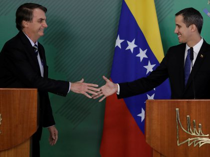 Juan Guaido y Jair Bolsonaro. REUTERS/Ueslei Marcelino