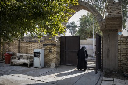 Um Junayd at the entrance to the sanctuary of the biblical prophet Joshua in Baghdad on January 29, 2021. (Ivor Prickett / The New York Times)