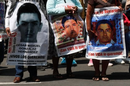 Relatives of missing students hold posters with their images during a protest outside the Supreme Court of Justice, before the sixth anniversary of the disappearance of 43 students of the Ayotzinapa Teacher Training College, in Mexico City, Mexico September 23, 2020. REUTERS/Henry Romero