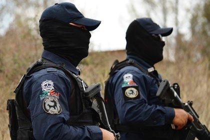 Además, se incautó un arma de fuego, 243.7 gramos de clorhidrato de heroína, y una báscula gramera (Foto: Europa Press)