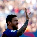 FC Barcelona's Lionel Messi waves to the crowd prior of the Joan Gamper trophy friendly soccer match between FC Barcelona and Boca Juniors at the Camp Nou stadium in Barcelona, Spain, Wednesday, Aug. 15, 2018. (AP Photo/Manu Fernandez)
