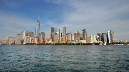NEW YORK, NEW YORK - SEPTEMBER 25: The New York City skyline is seen from a NY Waterway ferry as the city continues Phase 4 of reopening following restrictions imposed to slow the spread of coronavirus on September 25, 2020 in New York City. NY Waterway recently restored commuter ferry service from Port Imperial in Weehawken, NJ to their two Lower Manhattan terminals, Brookfield Place/Battery Park City and Pier 11/Wall Street, as well as service from 14th Street in Hoboken, NJ and the Hoboken/NJ TRANSIT terminal to Lower Manhattan. (Photo by Cindy Ord/Getty Images)