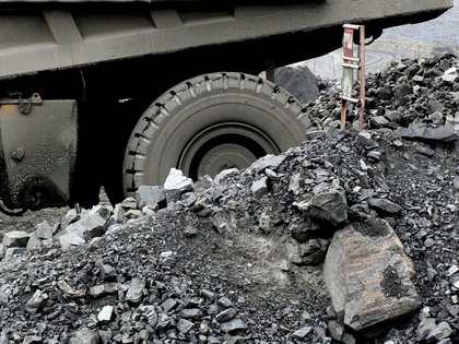 A truck carries excavated iron ore from the open pit of the Lebedinsky GOK (LGOK) iron ore mining and processing plant, operated by Metalloinvest Holding Co., in Gubkin, Russia, July 13, 2017. The new hot briquetted iron (HBI) production line at the Lebedinsky mine in Russia has an output capacity of 1.8m tons per year, a spokeswoman said by phone. Photographer: Andrey Rudakov/Bloomberg