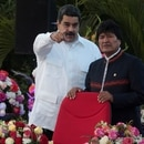 FILE PHOTO: Venezuela's President Nicolas Maduro speaks with Bolivia's President Evo Morales during the swearing-in ceremony for the third term of Nicaragua's President Daniel Ortega at the revolution square in Managua, Nicaragua January 10,2017. REUTERS/Oswaldo Rivas/File Photo