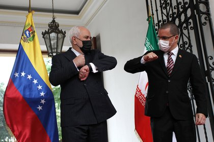 Iranian Foreign Minister Mohammad Javad Zarif was received by Venezuelan Foreign Minister Jorge Areaza ahead of a meeting at the Foreign Ministry headquarters in Caracas, Venezuela.  RATERS / Fausto Torreleba
