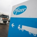 FILE PHOTO: A refrigerated truck leaves the Pfizer plant in Puurs, Belgium December 3, 2020. REUTERS/Yves Herman/File Photo