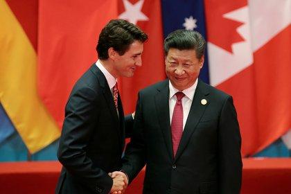 Justin Trudeau y Xi Jinping (Reuters)