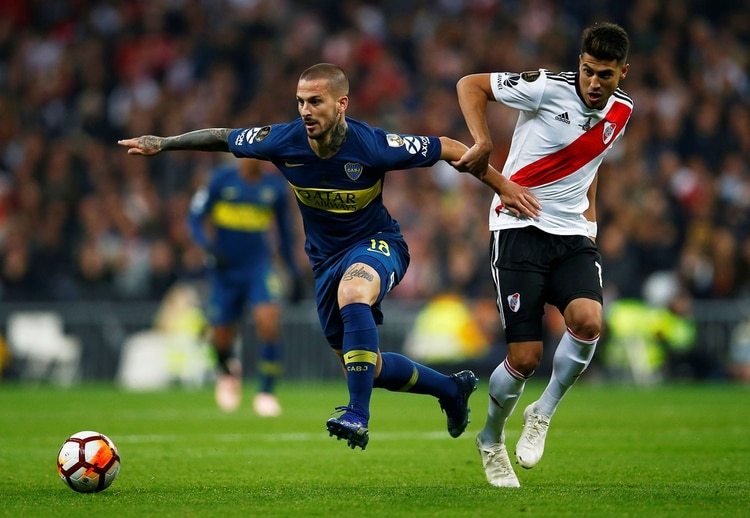 Soccer Football – Copa Libertadores Final – Second Leg – River Plate v Boca Juniors – Santiago Bernabeu, Madrid, Spain – December 9, 2018 Boca Juniors' Dario Benedetto in action with River Plate's Exequiel Palacios REUTERS/Javier Barbancho