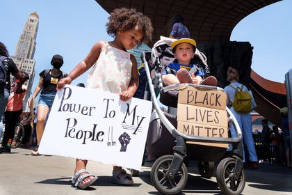 Uma Sarre (L), 3, and Samson Geller, 2, hold signs as families gather for a children's protest and march in support of the Black Lives Matter movement and in response to the death of George Floyd, an African-American man who died while in the custody of the Minneapolis police, in New York, New York, USA, 09 June 2020. EFE/EPA/JUSTIN LANE