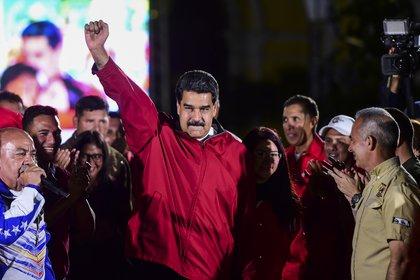 """Nicolás Maudro """"lleva años de esfuerzos por socavar la democracia y el estado de derecho"""", afirmó el Departamento del Tesoro de los Estados Unidos al sancionarlo. (Foto de Ronaldo Scemidt / AFP)"""