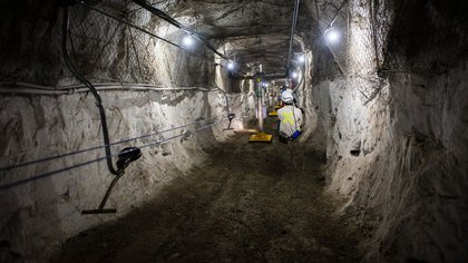 A visitor rides on a zip line inside the mine shaft during a media tour of the Sibanye-Stillwater Khuseleka platinum mine, operated by Sibanye Gold Ltd., outside Rustenburg, South Africa on Wednesday, Oct. 16 2019. Sibanye said its on track to resume paying dividends next year, should the company settle a wage dispute with platinum-mine workers without too much disruption. Photographer: Waldo Swiegers/Bloomberg