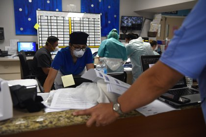 The collapse is already near at hand in Texas hospitals, as healthcare personnel exhaust efforts to treat patients (Reuters)