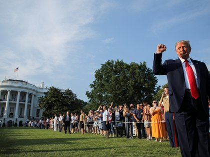 "U.S. President Donald Trump thrusts his fist as he arrives on the White House South Lawn to host a 4th of July ""2020 Salute to America"" to celebrate the U.S. Independence Day holiday at the White House in Washington, U.S., July 4, 2020.   REUTERS/Carlos Barria"