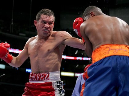 FILE PHOTO: ON THIS DAY -- May 28  May 28, 2005     BOXING - Mexican boxing great Julio Cesar Chavez delivers a strong right hand to United States' Ivan Robinson en route to a unanimous decision victory in what was billed as Chavez's farewell fight in Los Angeles.     Chavez, then 42, outpointed his younger opponent to pick up the win and improve his record to 107 wins, five losses and two draws.     Chavez, who was considered one of the best pound-for-pound fighters during his prime and held championships in three different weight classes, retired later that year after a loss to American boxer Grover Wiley.  REUTERS/Mike Blake/File photo