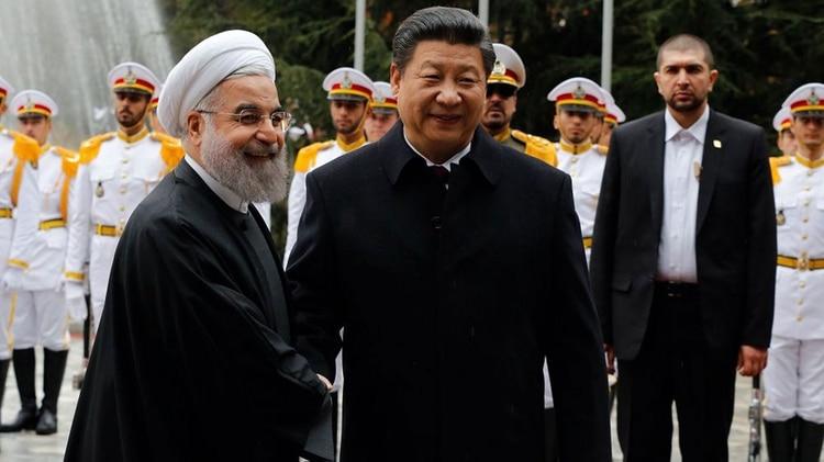 Xi Jinping y Hasan Rohani (AFP)