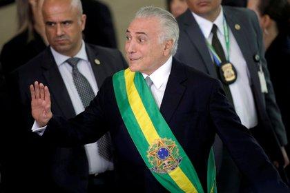 Michel Temer, ex líder del MDB, a punto de entregarle la banda presidencial a Bolsonaro el 1 de enero de 2019 (REUTERS/Ueslei Marcelino/File Photo/File Photo)