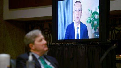 """Facebook CEO Mark Zuckerberg is seen testifying remotely as U.S. Senator John Kennedy (R-LA) listens during a Senate Judiciary Committee hearing titled, """"Breaking the News: Censorship, Suppression, and the 2020 Election,? on Facebook and Twitter's content moderation practices, on Capitol Hill in Washington, U.S., November 17, 2020. REUTERS/Hannah McKay/Pool"""