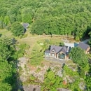 The property where Ghislaine Maxwell, former associate of late disgraced financier Jeffrey Epstein, was arrested by the Federal Bureau of Investigation (FBI) is seen in an aerial photograph in Bradford, New Hampshire, U.S. July 2, 2020. REUTERS/Drone Base