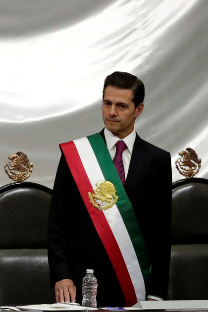 FILE PHOTO: Mexico's outgoing president Enrique Pena Nieto looks on as new President Andres Manuel Lopez Obrador (not pictured) takes an oath at the Congress in Mexico City, Mexico December 1, 2018. REUTERS/Henry Romero/File Photo