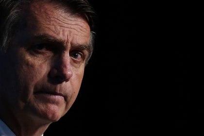 El presidente Jair Bolsonaro y sus hijos, diputados y senadores, mantienen una agencia de inteligencia paralela a la del Estado para atacar a sus rivales políticos. EFE/Marcelo Chello.