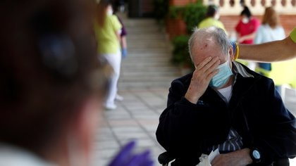 Florentino Martinez gets emotional as he sees his wife Maria Emilia on the first day family visits are resumed after three months amid the coronavirus disease (COVID-19) outbreak at the nursing home Centro Casaverde in Navalcarnero, outside Madrid, Spain June 8, 2020. REUTERS/Susana Vera