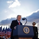 U.S. President Donald Trump speaks next to first lady Melania Trump as he departs from the Joint Base Andrews, Maryland, U.S., January 20, 2021. REUTERS/Carlos Barria