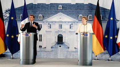 El presidente francés Emmanuel Macron junto a la canciller alemana Angela Merkel (Kay Nietfeld/REUTERS)