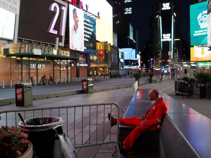 A street cleaner rests in a mostly empty Times Square after the 8 p.m. curfew continued Saturday night in response to looting during the Black Lives Matter's protests in the Manhattan borough of New York City, U.S., June 6, 2020. REUTERS/Andrew Kelly