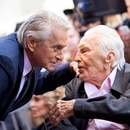(FILES) In this file photo taken on November 6, 2018 actor Kirk Douglas (R) attends a ceremony honoring his son actor Michael Douglas (L) with a Star on Hollywood Walk of Fame, in Hollywood, California. - US silver screen legend Kirk Douglas, the son of Jewish Russian immigrants who rose through the ranks to become one of Hollywood's biggest-ever stars, has died at 103, his family said on February 5, 2020. (Photo by VALERIE MACON / AFP)