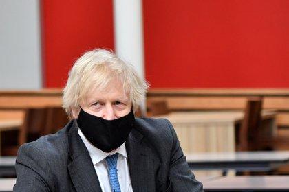 Britain's Prime Minister Boris Johnson visits the Accrington Academy, in Accrington, Britain February 25, 2021. Anthony Devlin/Pool via REUTERS
