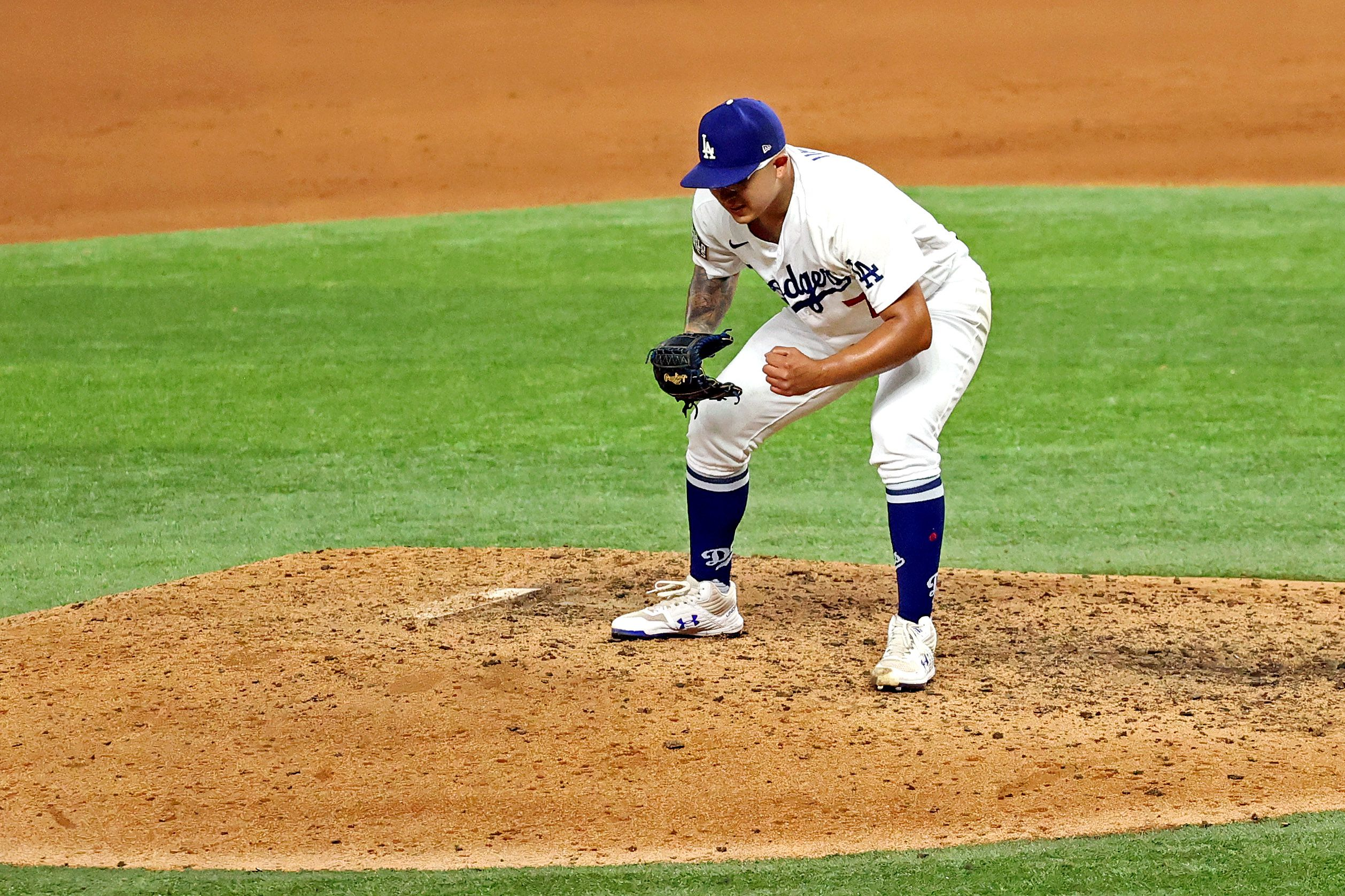 Oct 27, 2020; Arlington, Texas, USA; Los Angeles Dodgers starting pitcher Julio Urias (7) celebrates after recording the last out with a strike out against the Tampa Bay Rays to win the World Series in game six of the 2020 World Series at Globe Life Field. Mandatory Credit: Kevin Jairaj-USA TODAY Sports