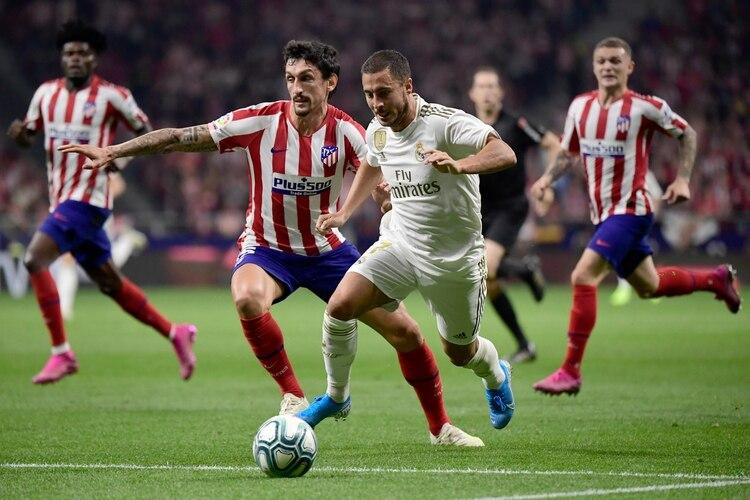 Atlético Madrid y Real Madrid se enfrentan por la Fecha 7 de la Liga española (AFP)