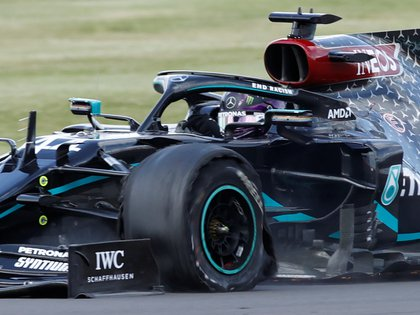 FILE PHOTO: Formula One F1 - British Grand Prix - Silverstone Circuit, Silverstone, Britain - August 2, 2020 Mercedes' Lewis Hamilton with a puncture after winning the race Pool via REUTERS/Andrew Boyers/File Photo