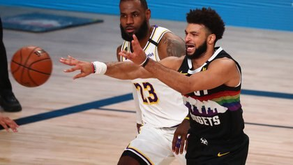 Sep 22, 2020; Lake Buena Vista, Florida, USA; Denver Nuggets guard Jamal Murray (27) passes the ball against Los Angeles Lakers forward LeBron James (23) during the first half of game three of the Western Conference Finals of the 2020 NBA Playoffs at AdventHealth Arena. Mandatory Credit: Kim Klement-USA TODAY Sports