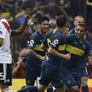 Boca Juniors' Ramon Abila (R) clebrates with teammates after scoring against River Plate during their first leg match of the all-Argentine Copa Libertadores final, at La Bombonera stadium in Buenos Aires, on November 11, 2018. (Photo by Eitan ABRAMOVICH / AFP)